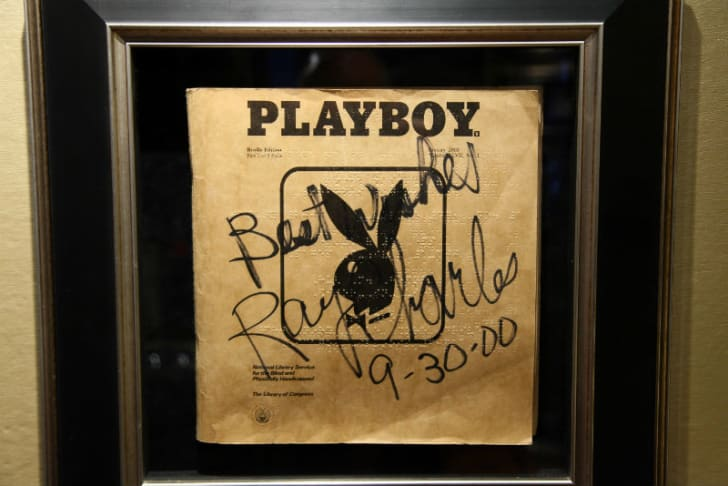 A Braille edition of 'Playboy' signed by Ray Charles hangs on a wall