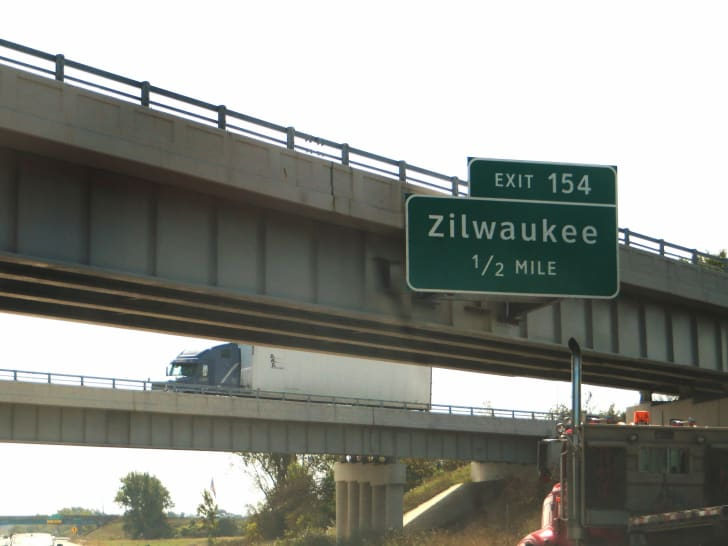 An exit sign for Zilwaukee, Michigan