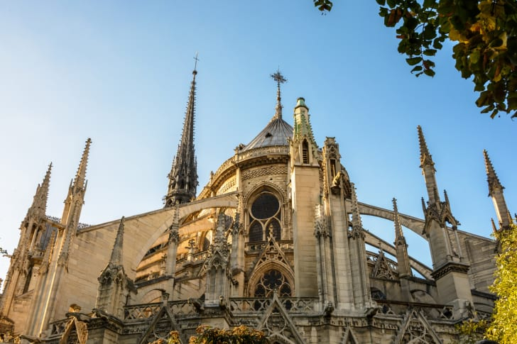 Low angle view of the East end of Notre-Dame de Paris cathedral at sunset with flying buttresses