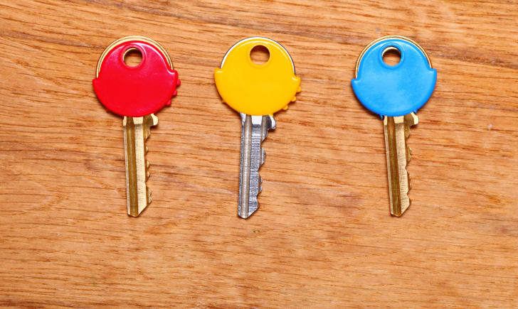 keys with colorful plastic caps on table