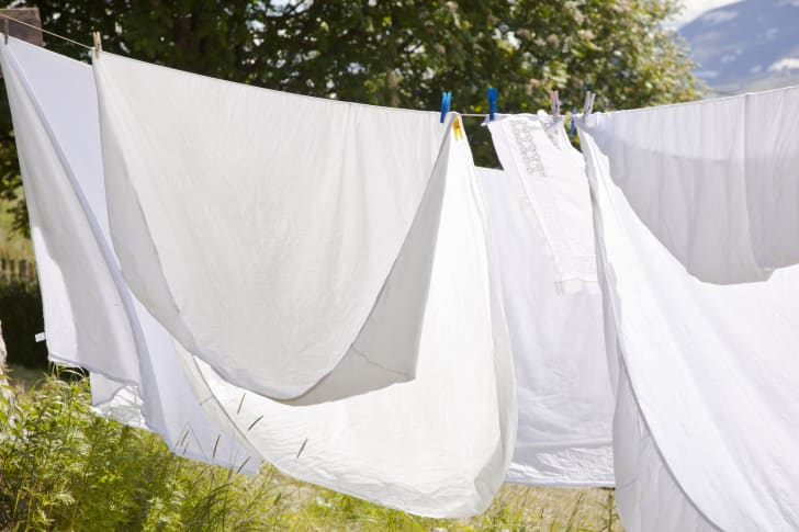 white sheets on clothesline