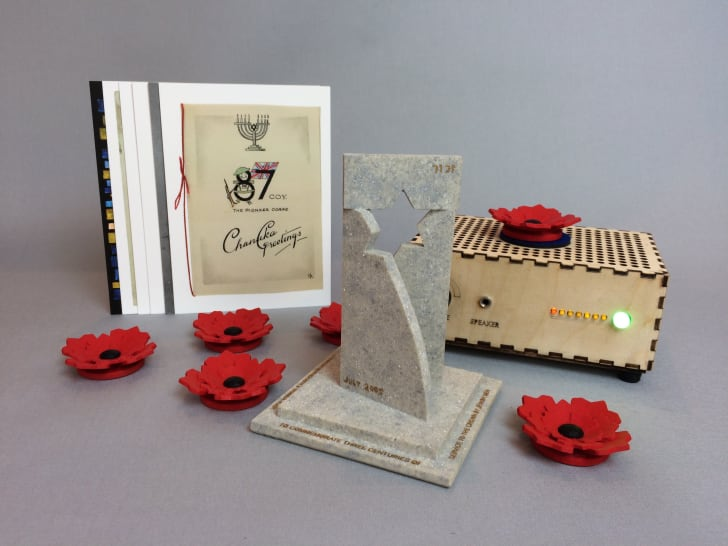 A Museum in a Box with red flowers designed for the Jewish Museum London