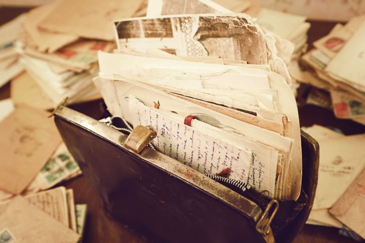 A packet of vintage letters stuffed into an old handbag
