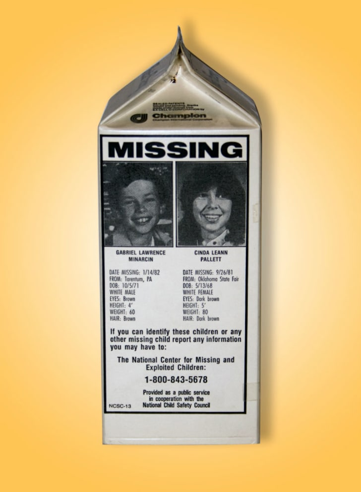 A milk carton displays photos of missing children.