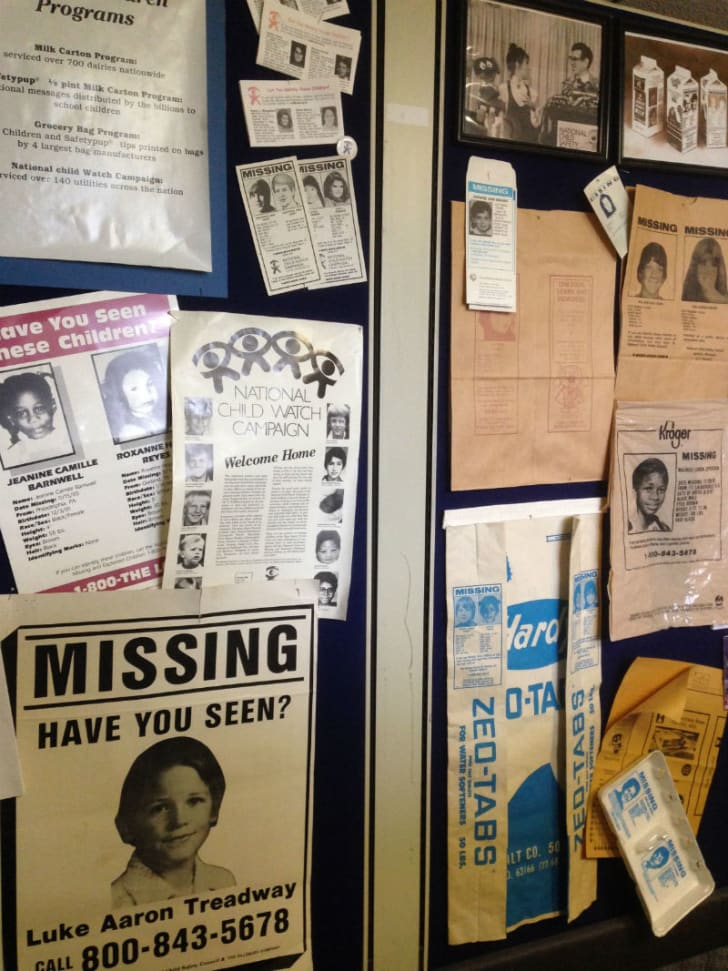 A number of missing-child posters hang on a wall