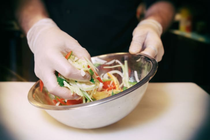 A man mixes ingredients in a bowl