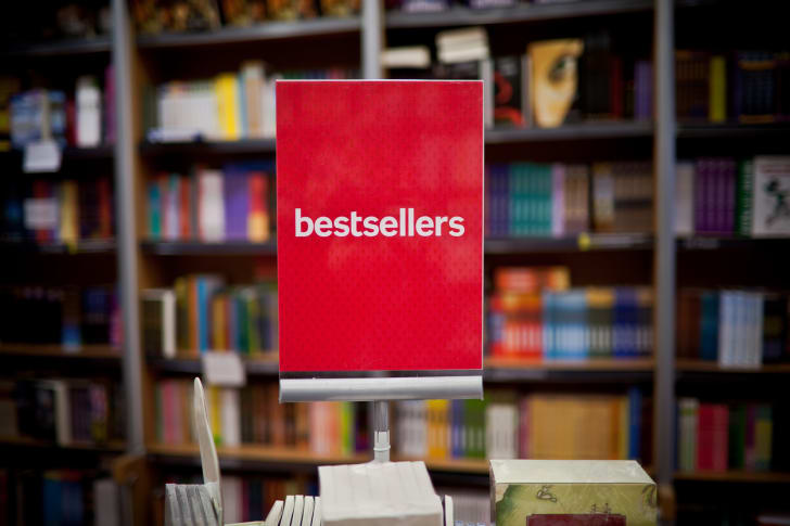 A red sign advertising bestsellers at a bookstore