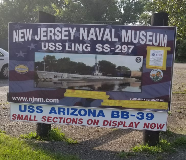 A sign for the New Jersey Naval Museum