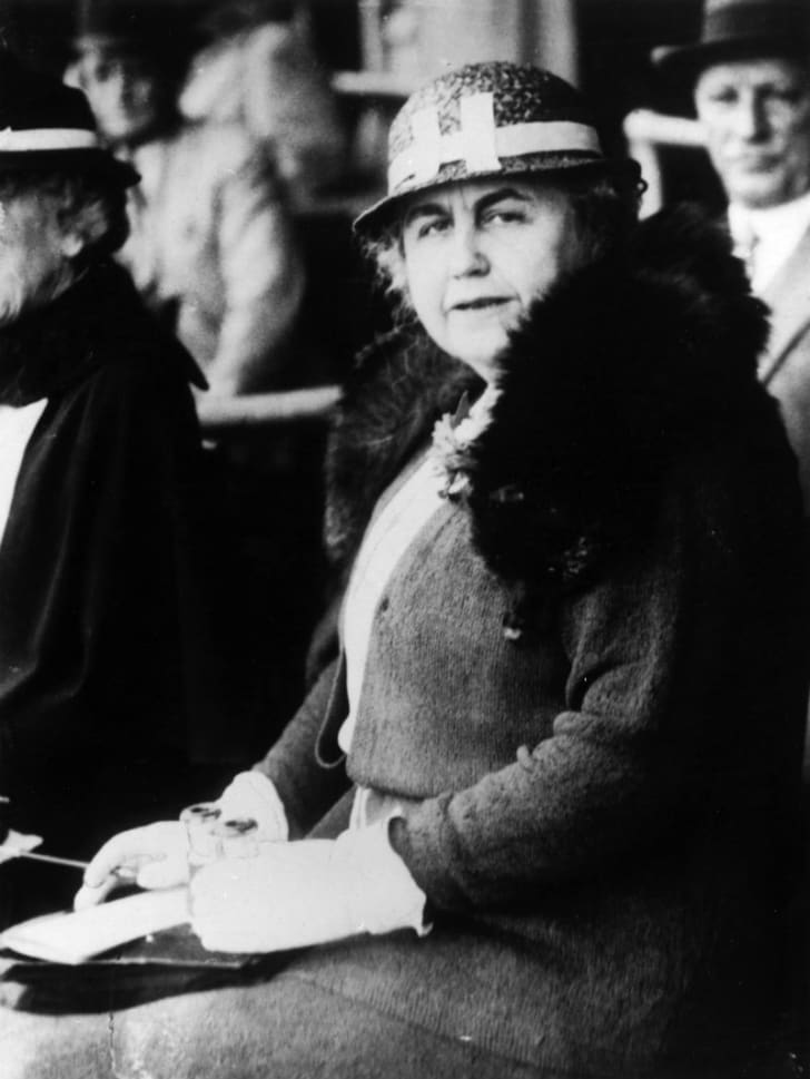Woodrow Wilson's wife, Edith, looks off to the side while being photographed