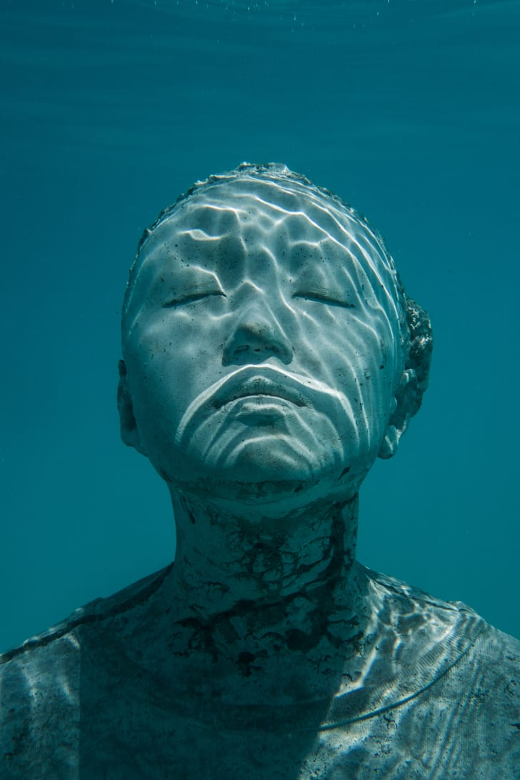An underwater sculpture of a person