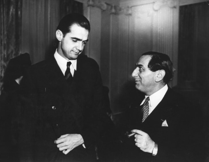 image of Howard Hughes standing next to some other guy