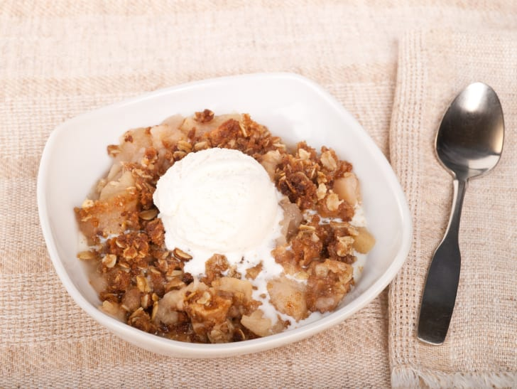 image of vanilla ice cream sitting on top of a bowl of what could be cereal, but probably isn't