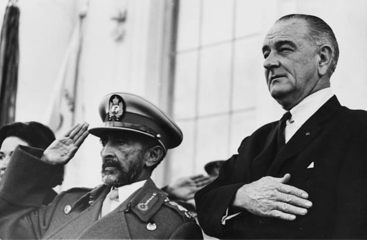 Emperor Haile Selassie saluting and US President Lyndon B Johnson holding his hand to his heart as the National Anthems are played, at the White House in Washington DC, February 18th 1967