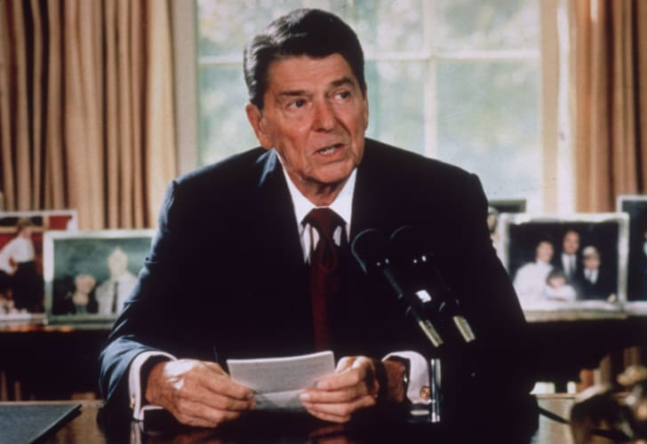 Ronald Reagan makes an address from behind his desk