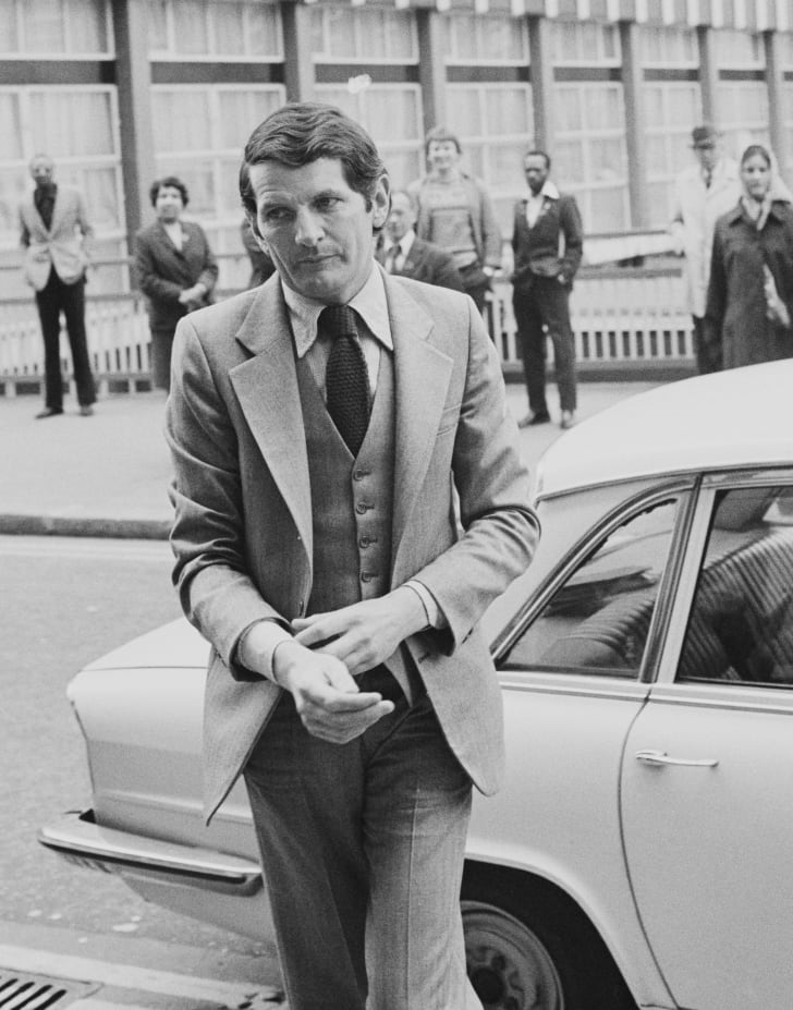 Norman Scott makes his way to court at the Old Bailey in London, during the trial of former Liberal Party leader Jeremy Thorpe, 21st May 1979. Scott has accused Thorpe and three other men of conspiracy to murder him