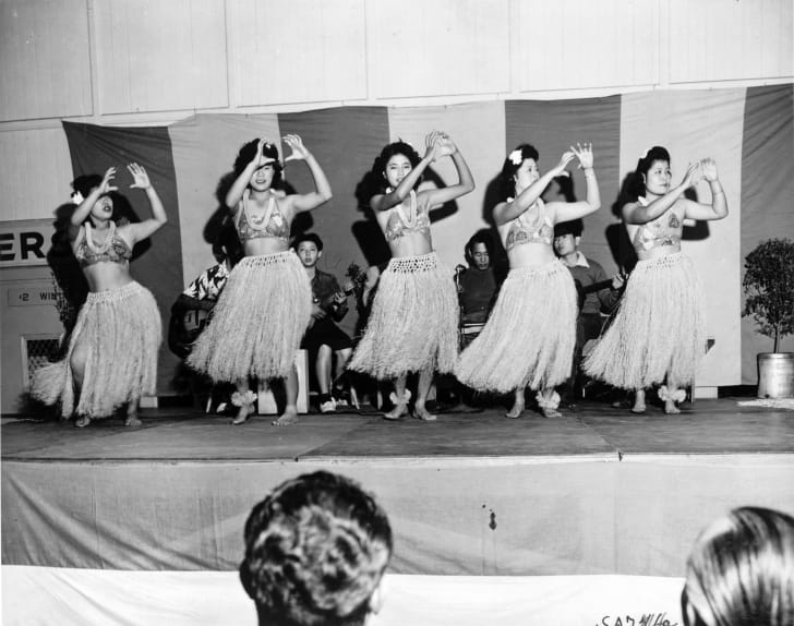 Japanese-Hawaiian hula dancers on an improvised stage during one of the frequent talent shows at Santa Anita (California) Assembly Center