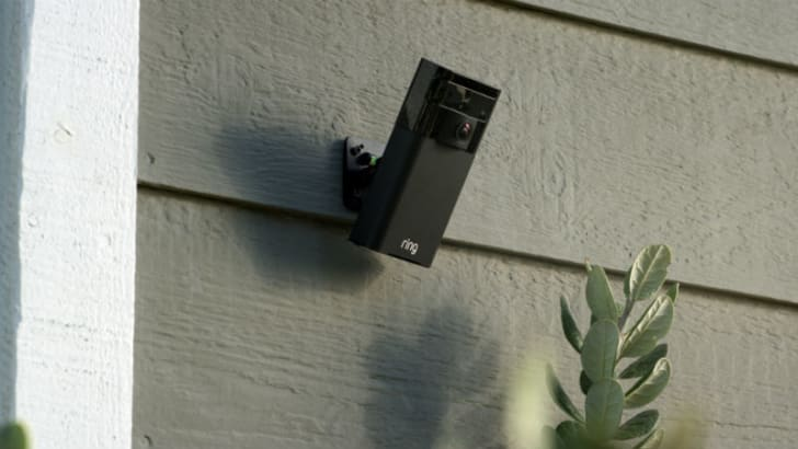 A Ring doorbell is mounted outside of a house
