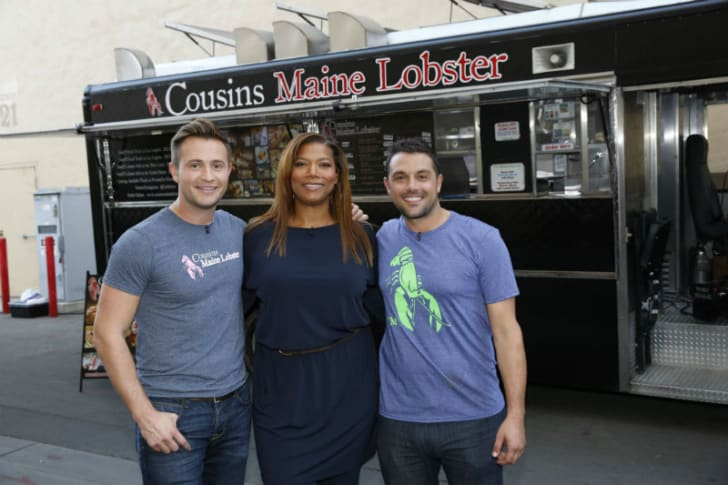 Cousins Maine Lobster co-founders pose for a photo with Queen Latifah