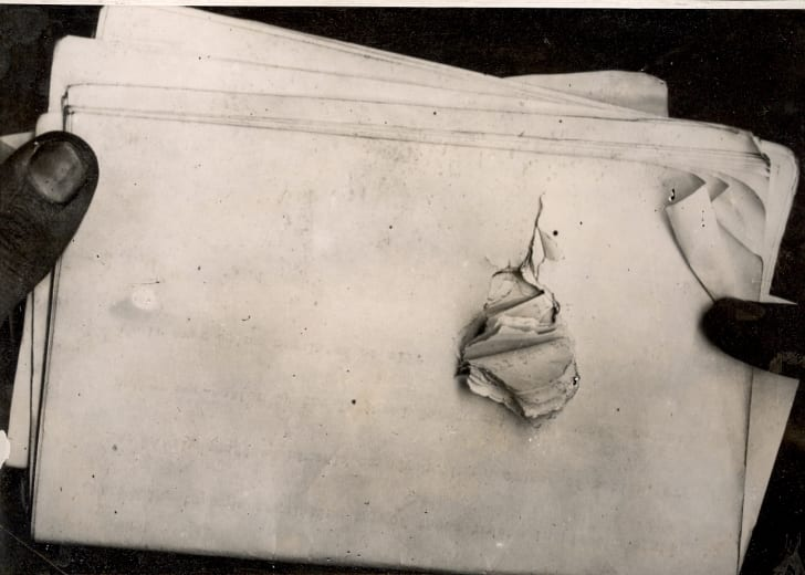 Roosevelt's speech pages showing where the bullet passed through.