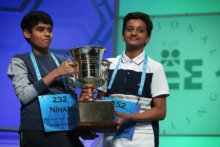 Spellers Nihar Saireddy Janga and Jairam Jagadeesh Hathwar hold a trophy after the finals of the 2016 Scripps National Spelling Bee