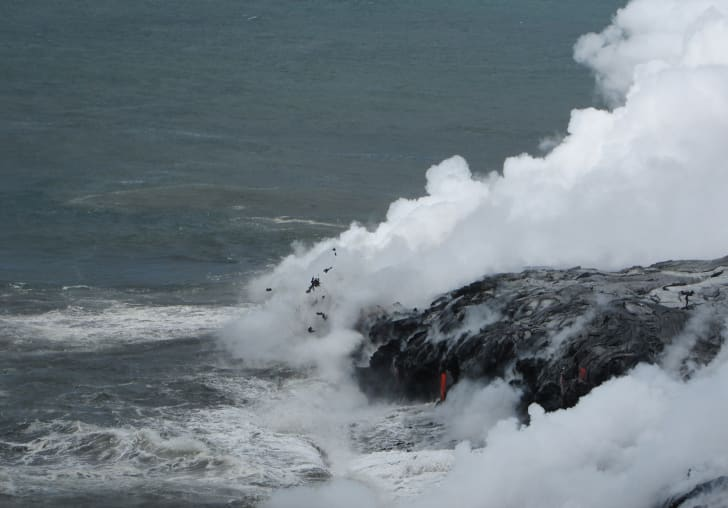 Laze blows out of the ocean near a lava flow
