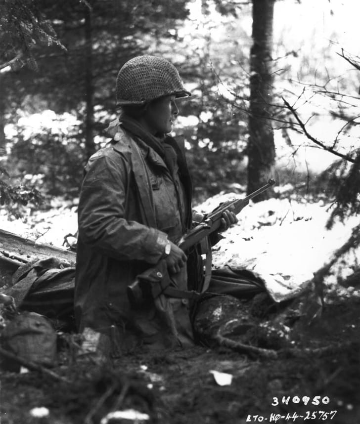 A 442nd squad leader looks for German movements in a French valley