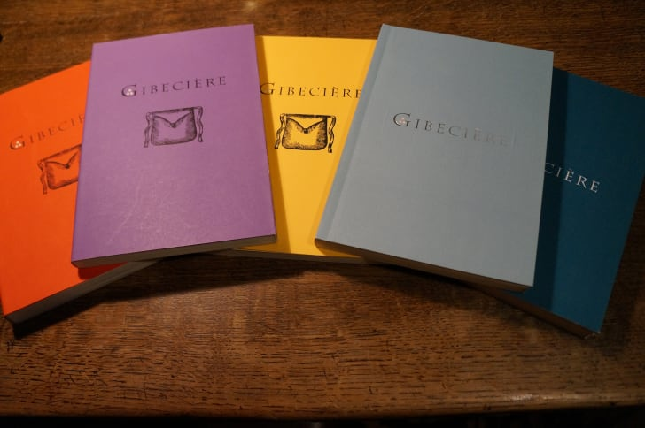 Several copies of the magical journal Gibeciere, produced by the Conjuring Arts Research Center