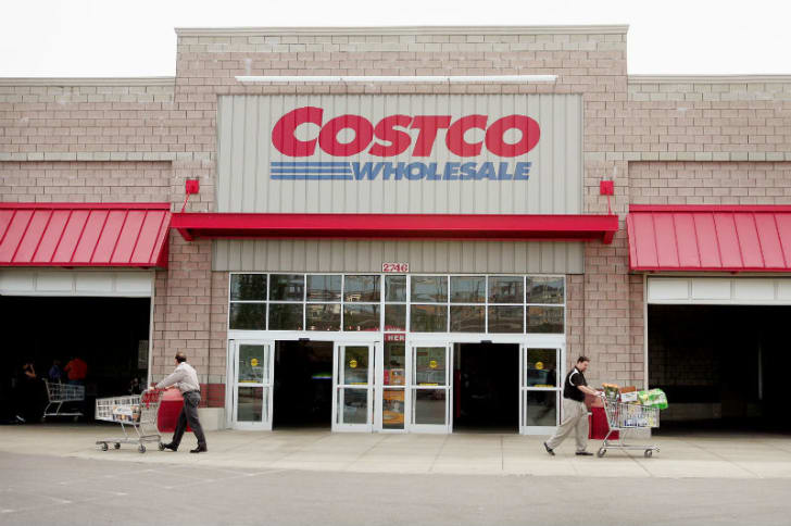 Shoppers appear in front of a Costco store