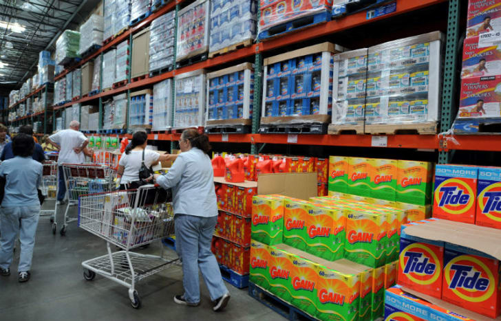 Shoppers go down an aisle at Costco