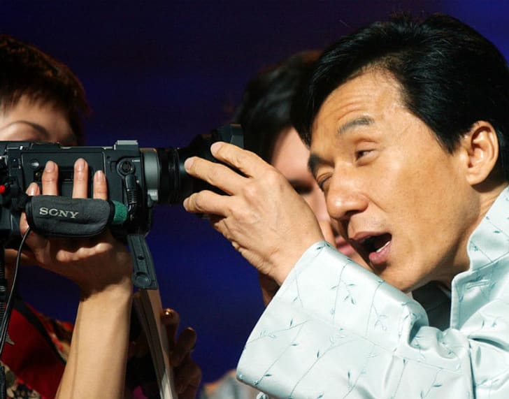 Jackie Chan looks into the lens of a camera