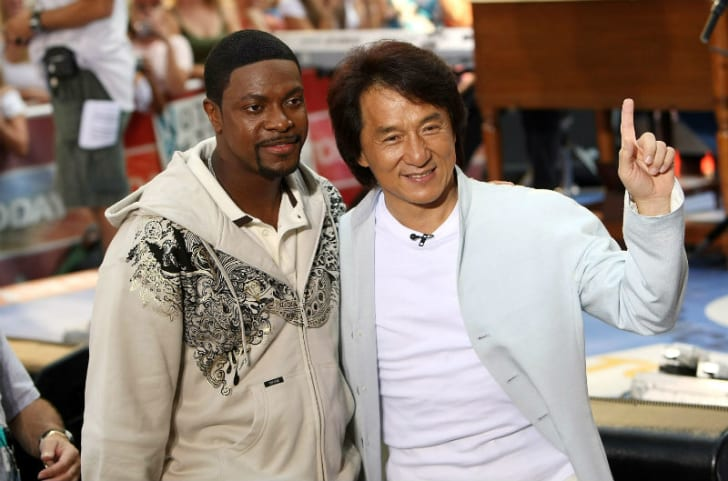 Jackie Chan and Chris Tucker pose for photos during a public appearance