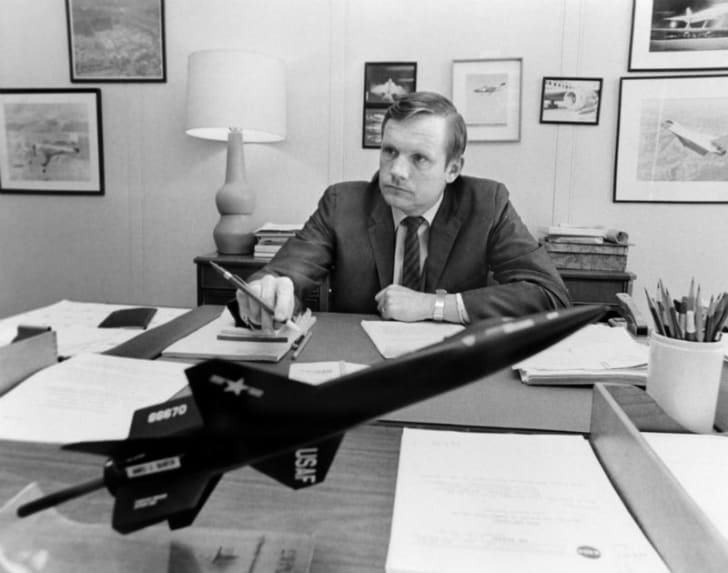 Newil Armstrong sits behind a desk in 1970