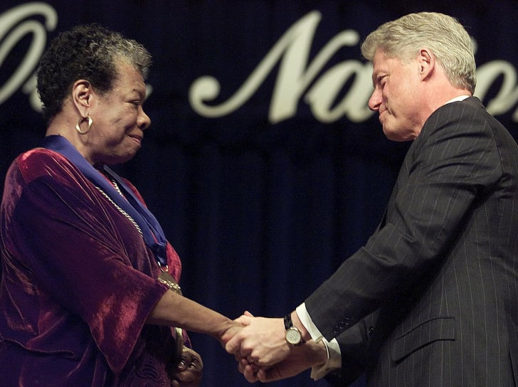 US President Bill Clinton(R) congratulates poet/writer Maya Angelou(L) after presnting her with the National Medal of Arts during ceremonies 20 December, 2000 at Constitution Hall in Washington, DC