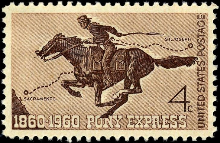 A commemorative stamp showing a Pony Express rider on a galloping horse