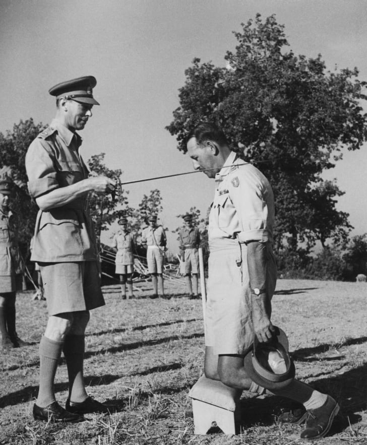 Lieutenant General Sir Oliver Leese (1894 - 1978) of the British Army receives a knighthood from King George VI, during the King's visit with the Eighth Army in Italy, 26th July 1944