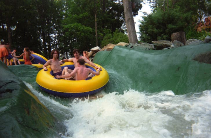 Guests ride down a raft at Action Park