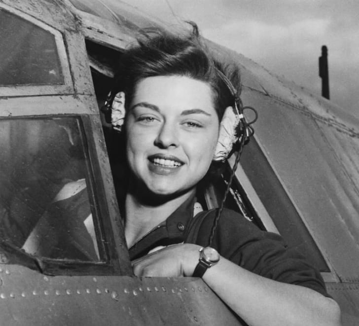 WASP pilot Elizabeth Remba Gardner looks out from her plane while on a Texas runway