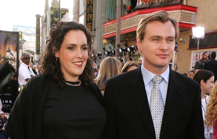 Producer Emma Thomas and director Christopher Nolan arrive at the premiere of 'Batman Begins'