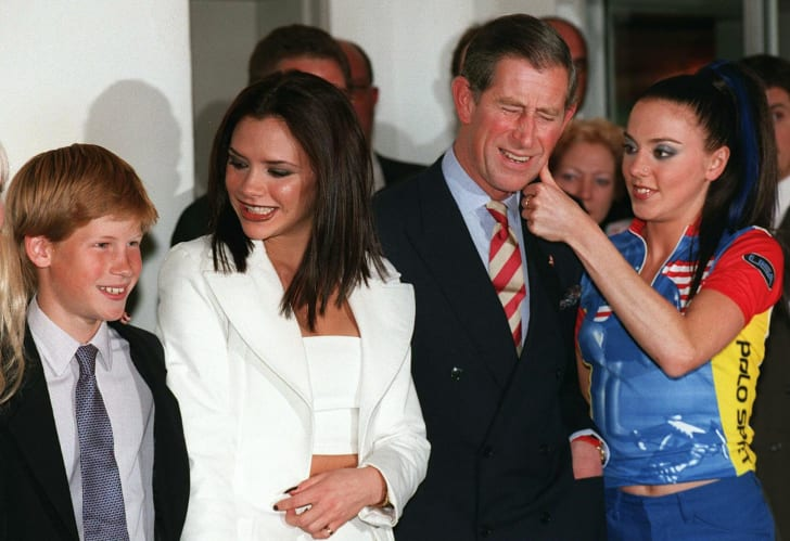 Prince Charles and Prince Harry pose with Spice Girls Victoria Beckham Mel C