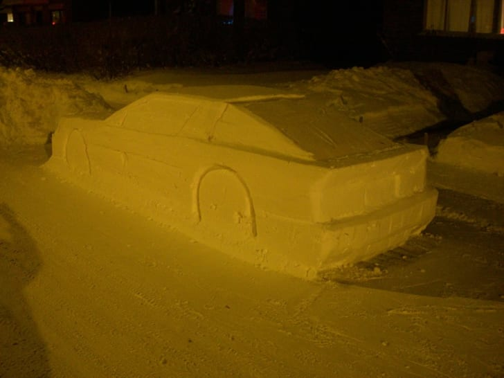 Snow sculpture of car.