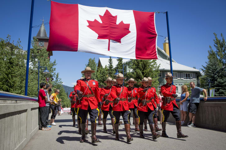 Officers of the Royal Canadian Mounted Police marching in a Canada Day parade