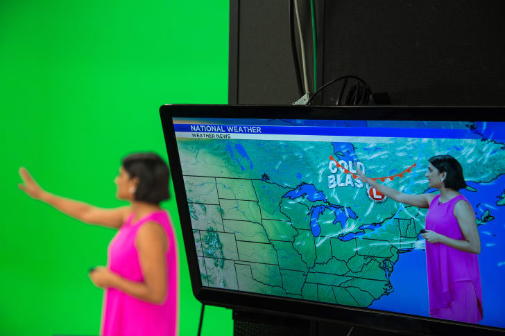 A view of a meteorologist as seen on-screen and in the studio against a green screen