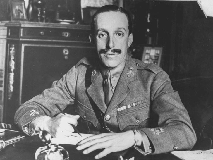 The King of Spain working at his desk.