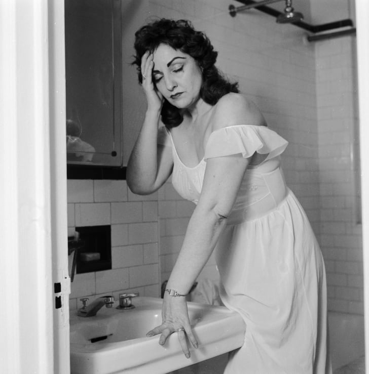 A woman suffering from a hangover circa 1956