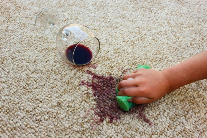 Cleaning spilled wine on a carpet