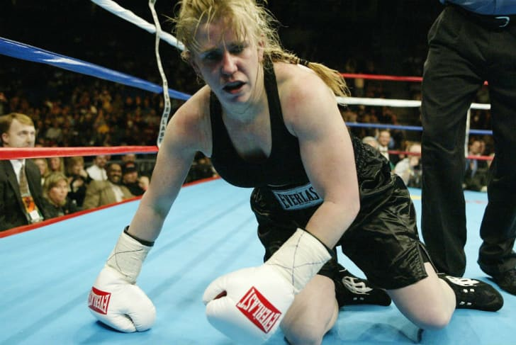 Tonya Harding rises from the canvas during a boxing match