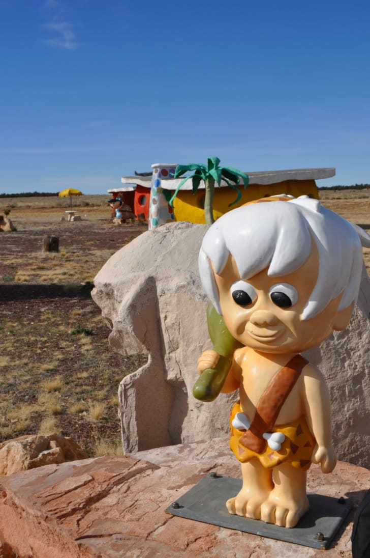 A statue of Bam-Bam at the Flintstones park in Arizona