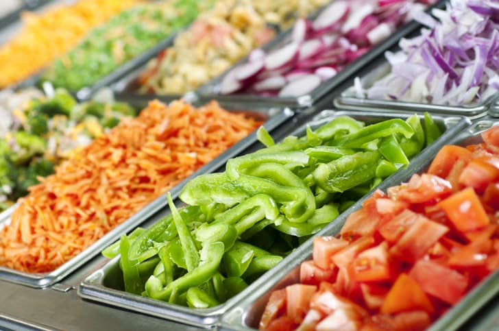 An array of vegetables at a salad bar