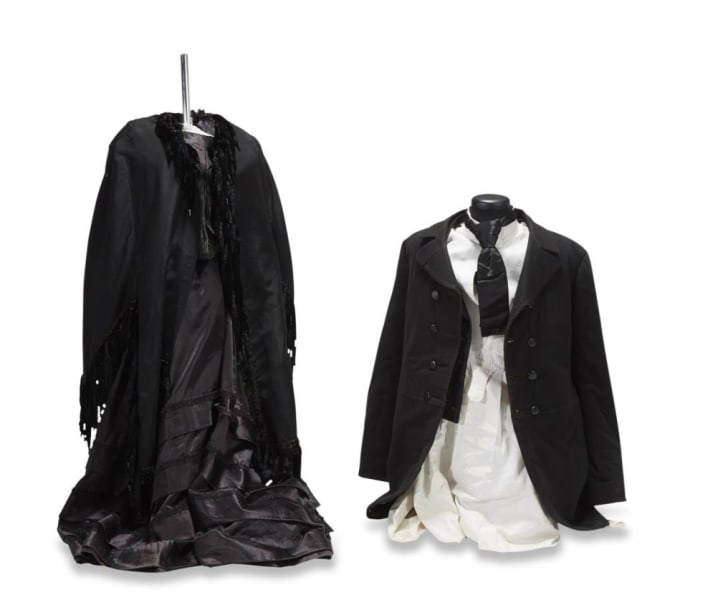 Group of 19th century ladies and gentleman's mourning costumes, from the Collection of Irvin & Anita Schorsch