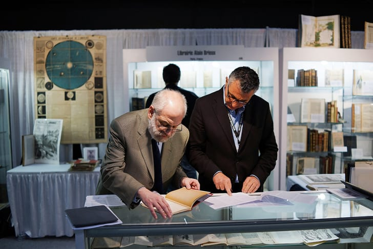 Two men at the Park Avenue Armory during the New York Antiquarian Book Fair in 2013